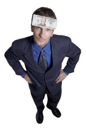 Businessman with money stuck to his forehead Stock Photo
