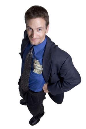 remuneraci�n: Hombre de negocios con el dinero en su bolsillo Foto de archivo