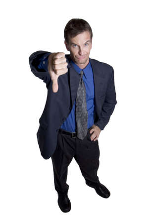 Businessman gesturing thumbs down Stock Photo