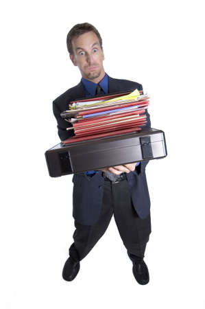 tipping: Overworked businessman tipping over from carrying too many folders