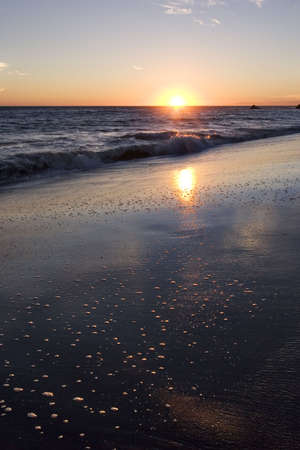 wisps: Malibu Sunset with wisps of clouds Stock Photo