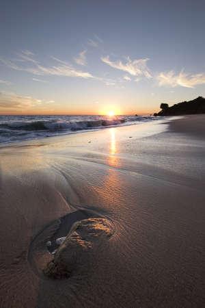 Malibu Sunset with wisps of clouds photo