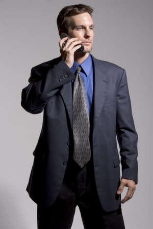 Confident businessman on cellular phone