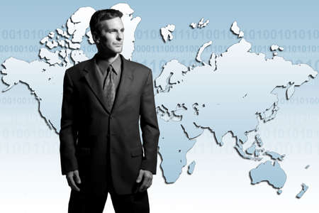 Businessman standing in front of world map