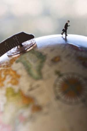 Business travel figure on globe