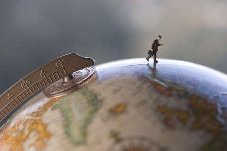 globetrotter: Business travel figure on globe
