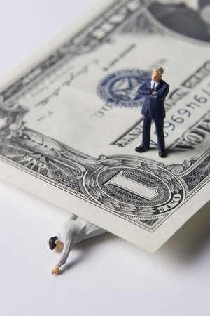 Business figures with money. Banco de Imagens