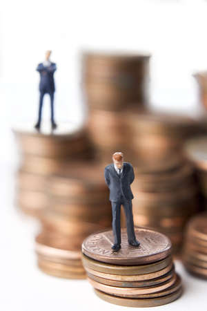 Business figures with money. Stock Photo