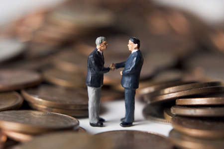 hoard: Business figures with money. Stock Photo