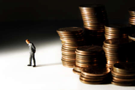 corporate greed: Business figures with money. Stock Photo