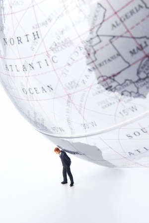 globetrotter: Business figurines and earth globe.