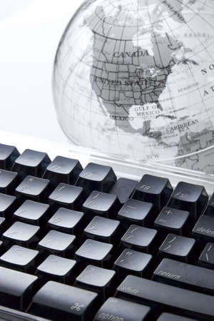 Computer keyboard and earth globe Stock Photo