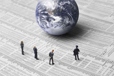 business figures and earth on a stock report