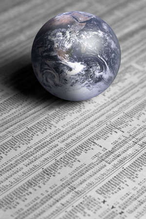 monthly salary: Earth on stock report Stock Photo