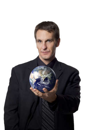 Businessman holding the earth Stock Photo