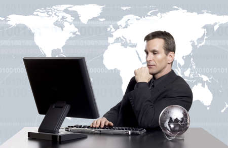 Businessman sitting at desk 免版税图像