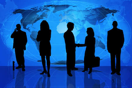 Silhouette of business professionals standing in front of a world map photo