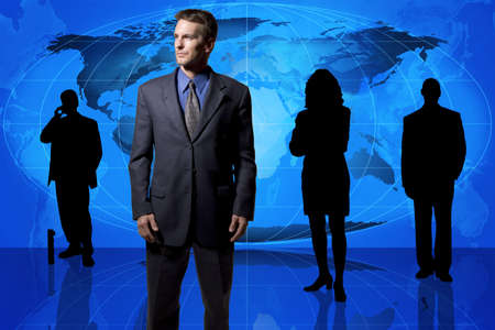 Business professionals standing in front of a world map