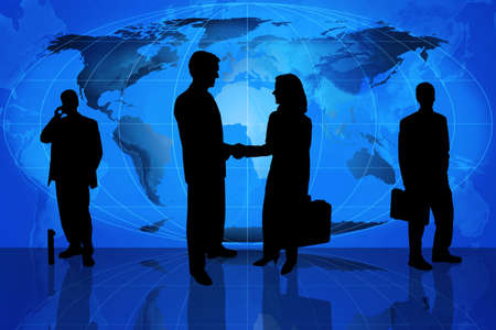 Silhouette of business professionals standing in front of a world map