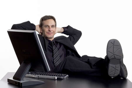 Businessman with his feet up on his desk
