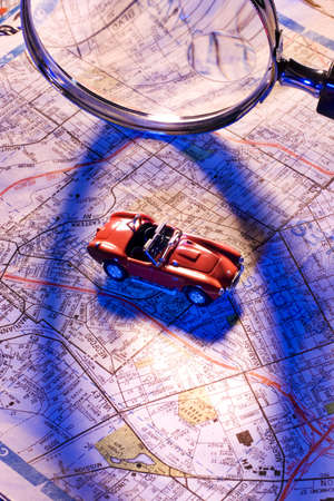 Magnifying glass, map and toy car