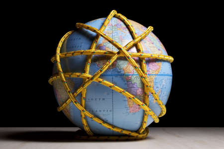 peril: Earth globe wrapped with rope