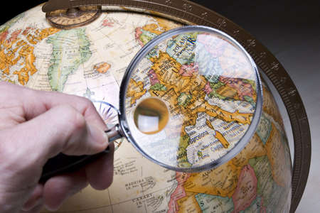 globetrotter: Globe and magnifying glass Stock Photo