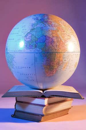 Globe on stack of books