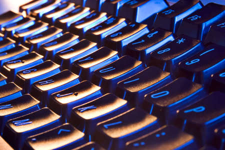 Computer Keyboard with blue and orange lighting Stock Photo
