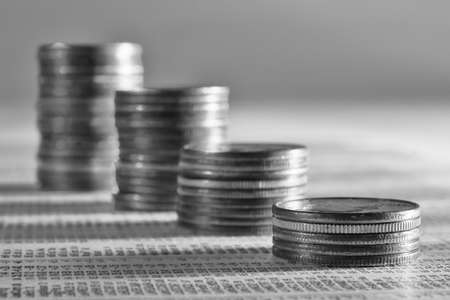 mutual fund: Coins stacked as a falling graph on stock report Stock Photo