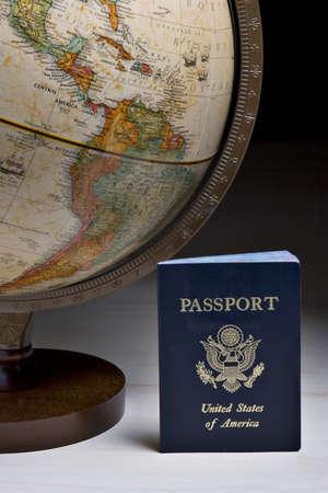 passport and antique earth globe Banco de Imagens