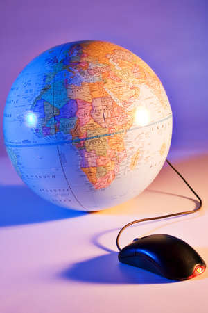 cram: Computer mouse connected to an earth globe