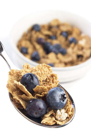 fortified: Spoon and bowl of breakfast cereal with blueberries