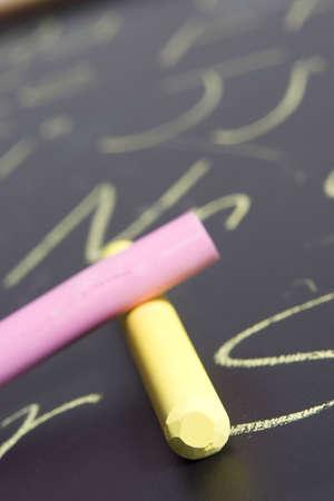 Chalk on Chalkboard with alphabet written on it. photo