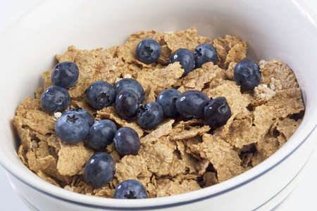 fortified: Bowl of breakfast cereal with blueberries Stock Photo