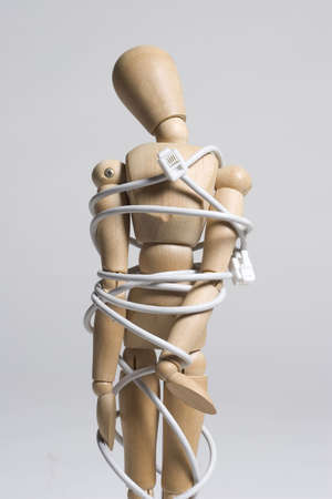 Artist mannequin tied up with a phone cord