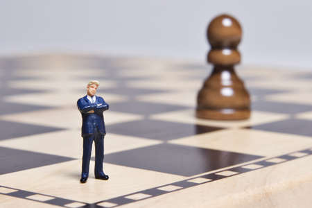 Business Figurine and chess photo