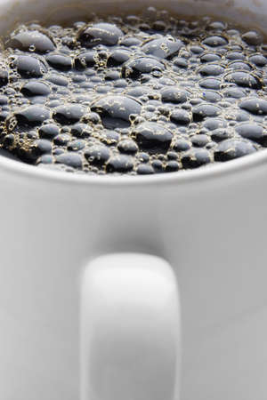 boiling: Boiling hot cup of coffee on white Stock Photo