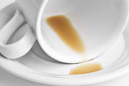 Cup of coffee turned on its side with only a few drops of coffee left. Stock Photo - 4027219