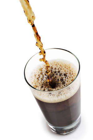 the carbonation: Pouring a soda into a glass on white