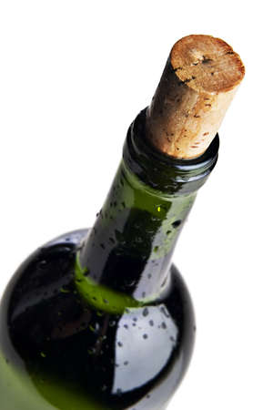 Wet bottle of red wine against a white background
