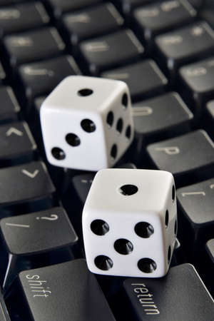 Dice on a computer keyboard Stock Photo - 4890847