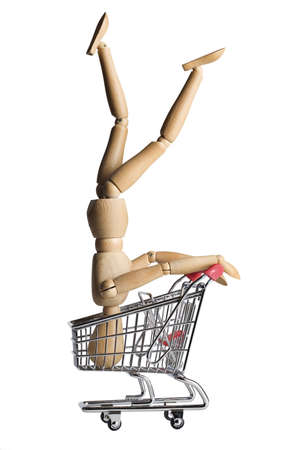 headstand: Mannequin doing a headstand in a shopping cart Stock Photo