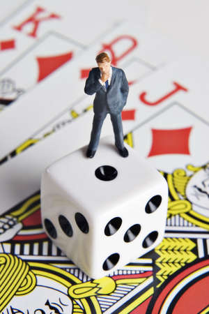 conspire: Business figurine, dice, and playing cards
