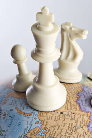 takeover: Chess pieces on an earth globe