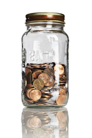 nestegg: jar half full of pennies
