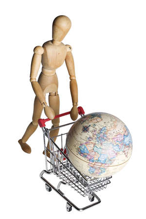 Mannequin pushing a shopping cart with an earth globe photo