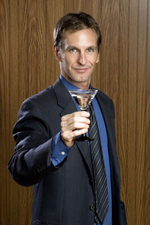 obnoxious: Businessman drinking a cocktail