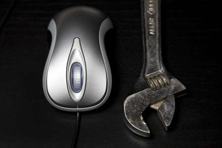 Computer mouse and wrench photo