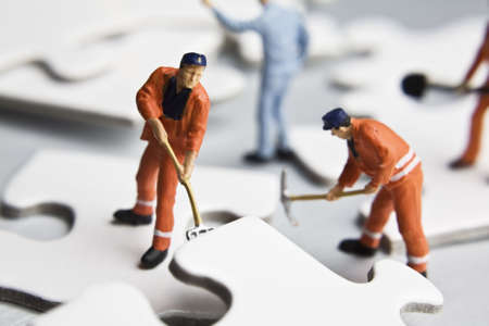 Worker figurines placed with puzzle pieces Stock Photo - 7181695